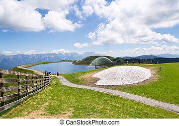 Beautiful pond on Wildenkarkogel Mountain in Alps,...