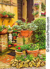 Beautiful porch decorated with flowers in the countryside, Italy