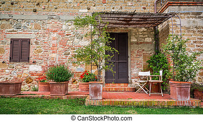 Beautiful porch in front of an old house in Tuscany