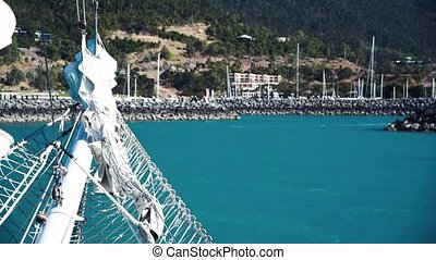 Beautiful port of Airlie Beach as seen from a moving boat, Queensland, Australia.