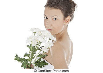 Beautiful portrait of a young sexy woman with a white flower.