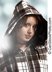 beautiful portrait of young woman wearing hoody