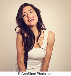 Beautiful positive laughing young woman in white shirt and...