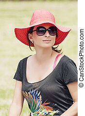 Beautiful positive woman in a red hat