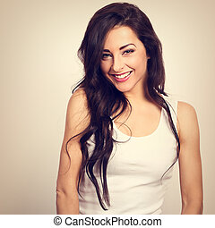 Beautiful positive woman in white shirt and long hair toothy...