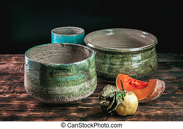 Beautiful pottery handmade on brown wooden background