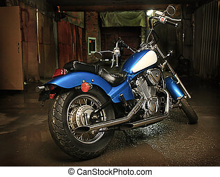 motorcycle in garage - beautiful powerful blue motorcycle in...