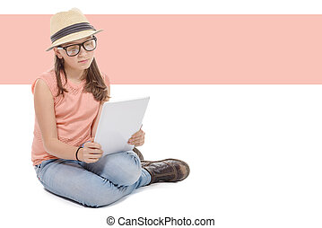 Beautiful pre-teen girl with a tablet computer.