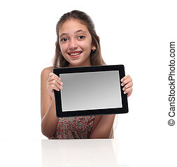 Beautiful pre-teen girl with a tablet computer. Isolated