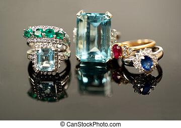 emerald, aquamarine, ruby, and blue sapphire jewelry with diamond settings