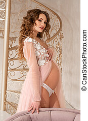 beautiful pregnant girl in pink dress
