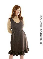 Beautiful pregnant redhead woman fashion