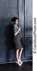 Beautiful pregnant woman at home