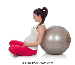 Beautiful pregnant woman doing pilates isolated on white...