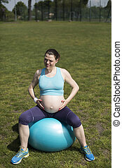 Beautiful pregnant woman gym fitness