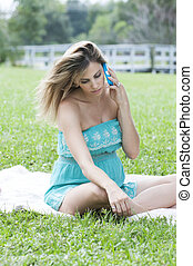 beautiful Pregnant Woman in a meadow