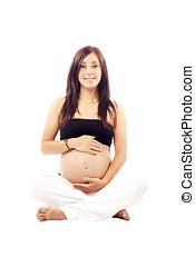 Beautiful pregnant woman performing yoga