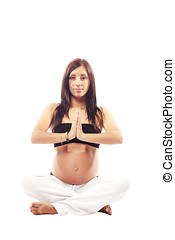 Beautiful pregnant woman performing yoga
