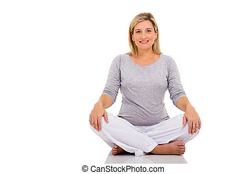 pregnant woman relaxing on floor