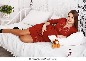 pregnant woman resting in bed