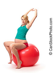 Beautiful pregnant woman using gym ball