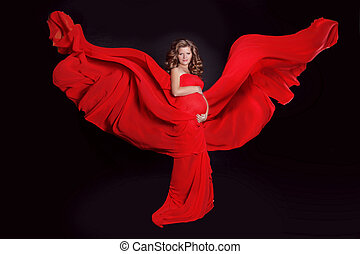 Beautiful Pregnant woman with red blowing tissue isolated on black background. Fairy.