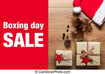 Beautiful presents, Boxing Day sale concept, desk with santa hat, view from above