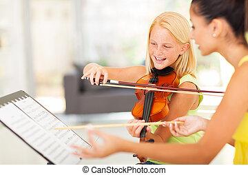 preteen girl in music class