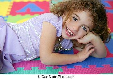 Beautiful princess little girl smiling lying floor