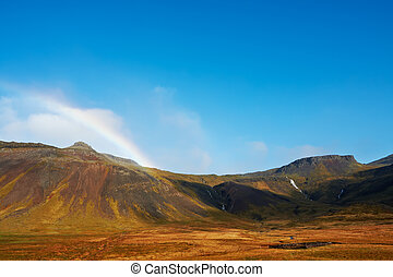 Beautiful rainbow over the mountains, North Fjords Iceland