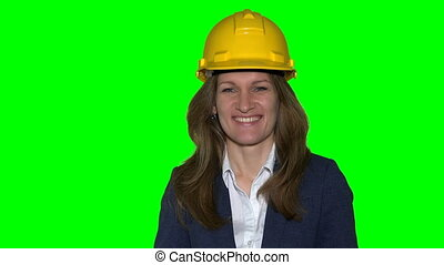 Beautiful realtor business woman with helmet hold new house construction keys.