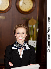 Beautiful receptionist ready to welcome tourists - Portrait...