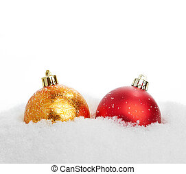 beautiful red and gold Christmas ball in snow
