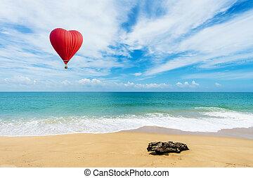 Beautiful Red balloon in the shape of a heart at Mai khao beach, Phuket, Thailand