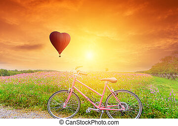 Beautiful Red balloon in the shape with bicycles at sunset