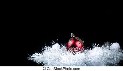 beautiful red Christmas ball on a black background.