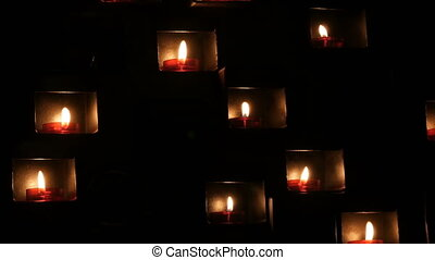 Beautiful red church candles for prayers in special niches ...