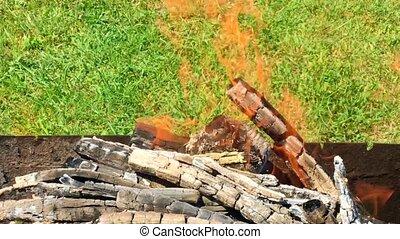 Beautiful red fire from slice wood, dark grey black coals...