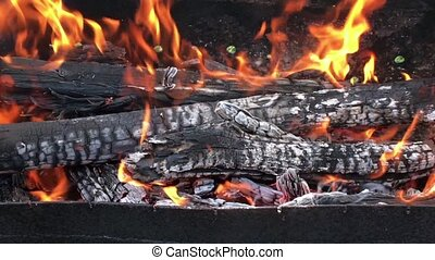 Beautiful red fire from slice wood, dark grey black coals...