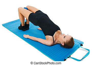 Beautiful fit red girl practicing pilates or callanetics with ball and blue yoga mat