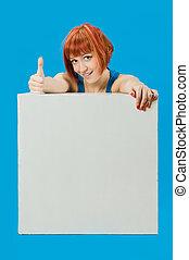 Beautiful red girl with blank board
