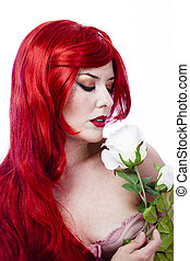 Beautiful red hair sexy woman with white rose over white background
