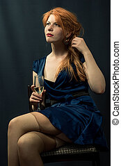 beautiful red-haired girl in a blue dress.