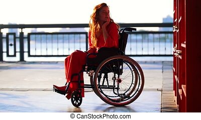 Beautiful Red-Haired Girl In A Wheelchair Takes Out Of The...