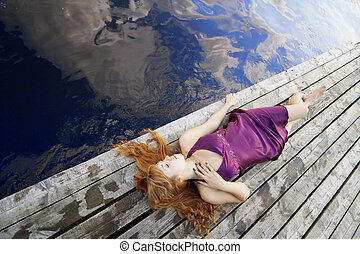Beautiful red-haired girl on the pi - Images of a beautiful...