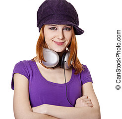Beautiful red-haired girl with headphones. S