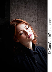 Beautiful red-haired girl with plump lips. . A natural...