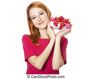 Beautiful red-haired girl with present box
