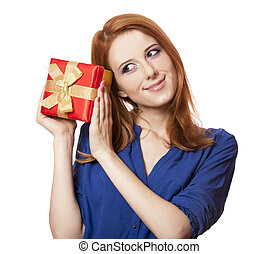 Beautiful red-haired girl with present box.