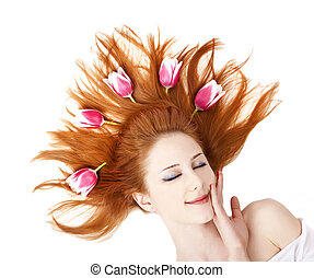 Beautiful red-haired girl with tulips.